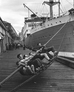 Child migrants swing on the ropes of the Dutch passenger ship, MS Sibajak, shortly after disembarking at Woolloomooloo, Sydney, 11 June 1953. Photo: supplied.