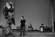 David Covarrubias tries to stare down the Giant Robot Mech, made as a collaboration between the Stan Winston School, Legacy Effects, Wired Magazine and YouTube for Geek Week, for which he was a lead mechanical designer