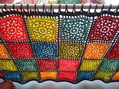 here's a curtain idea...good use for leftover yarn stash. crochet a square here, a square there...and stitch together.