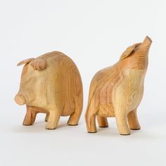 """Some Pig Bookends  $148.00  Hand-carved from reclaimed pine timber, this pair of blue-ribbon bookends holds your library in place with a dose of humor.    - Reclaimed pine timber  - Imported    8""""-9.5""""H, 5""""W"""