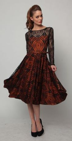 This is my favorite dress in the store right now! It's so hard to find a beautiful long sleeve dress these days, and this one is just stunning - Designer = Eva Franco