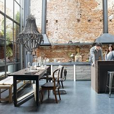 low hanging chandelier // brick walls // grey // #loft