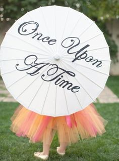 Shade your flower girl from the sun with this seriously sweet parasol