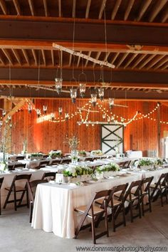 Love the branch with hanging lanterns. Great way to suspend them in a designer way