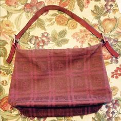 """Large pink tweed Dooney and Bourke shoulder bag Pink tweed bag, zip top, in excellent condition with no stains or rips to the outside of the bag, but does show some minor wear to outside corners. Cell phone pocket inside the bag does show a water stain (see pics), features a hanging key clip inside the bag and one inside pocket. Measures 11"""" x 9"""" x 5"""" with a 12 inch strap drop Dooney & Bourke Bags Shoulder Bags"""