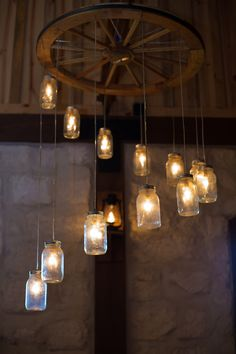 My inspiration for my chandelier project… Now anyone know where I can get my hands on a wooden wagon wheel?? Wagon Wheel Mason Jar Chandelier. $350.00, via Etsy.