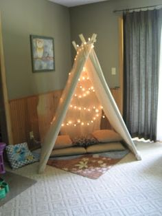 A fun idea for fairy lights and kids. Make them a tent or fort and light it with mini lights. Perfect for a reading area. #FairyLights