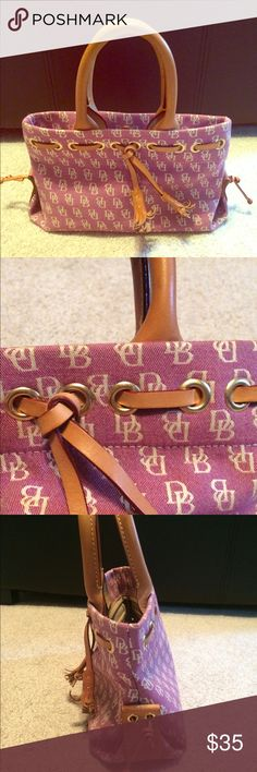 Dooney & Bourke Mini Tote Great barely used mini tote in near perfect condition! Measures 10l x 6w. Beautiful dark pink color. Dooney & Bourke Bags Mini Bags
