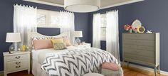 dark walls, white curtains, chevron bedding