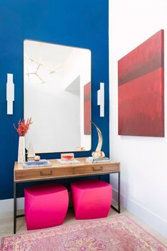 pos of hot pink make for a wow-worthy entryway console table