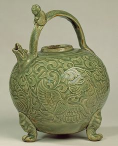 Ewer, Northern Song dynasty (960–1127), 11th–12th century; Yaozhou ware China Stoneware with incised, carved, and relief decoration under glaze; H. 8 1/4 in. (21 cm)
