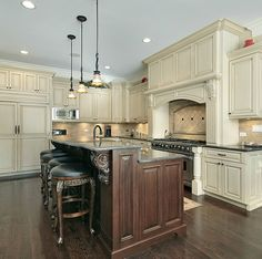 Luxury white kitchen with beautiful 2-tier island with breakfast bar.