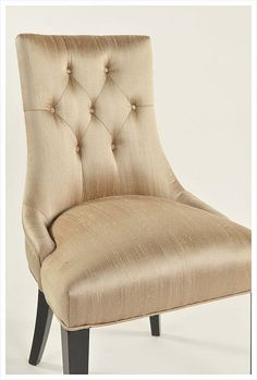 Diamond tufted silk dining chair with black lacquer legs. Wharton Hunt can build this for you.  Learn more about how Wharton Hunt does this at http://www.whartonhunt.com/portfolio/custom-hospitality-seating/