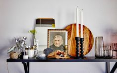 A good way to set a display is by using larger or taller objects at the sides and back then work down towards the middle using smaller or flatter objects in front. We love adding props like mirrors, old paintings, balls of string, metallic candlesticks and paper bags to bring a variety of textures t