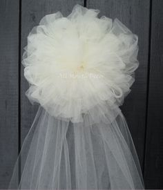 Ivory Tulle Half Pom Wedding Pew Bow - 7 Inch. Beautiful for home and wedding decor, parties, ceremonies, bridal showers, baby showers, arches, chairs, church aisles. - Color: Ivory - Size: Approximat