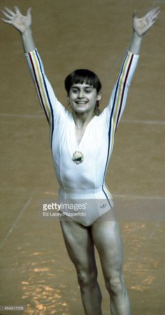 1976. Gymnast Nadia Comaneci of Romania acknowledges the crowd after her gymnastics performance during the Summer Olympics Games in Montreal on 21st July 1976. She won a total of three gold medals - and two more during the 1980 Moscow Olympic Games.
