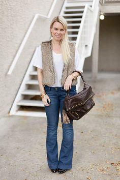 Fall Outfit Idea//flared jeans, white t-shirt, and faux fur vest