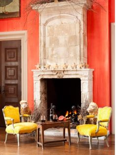 Coral Venetian Plaster Walls really frame this Antique Stone Fireplace. Handsome Room.