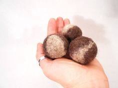 "🐱 Set of three felt balls – wool cat toys. Your cat will love these felted balls! These cute little cat toys are made from natural wool with wet felting techniques using water and soap, 100% handmade.  🐱 Pure wool. These cat balls can be rolled, chased, chewed, ""killed"". Your cat will like the toy because cats are naturally attracted by the wool odor. The cat will play for hours with these little toys all over the house!  Each ball is about 4 cm (1,6 in). Felted cat toys are handmade so…"
