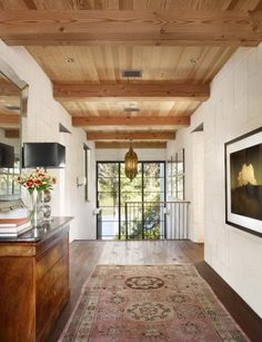 Steel frame doors + white walls, natural wood ceiling - Ryan Street & Associates