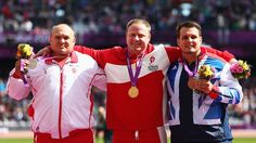 (L-R) Silver medallist Darko Kralj of Croatia, gold medallist Jackie Christiansen of Denmark and Bronze medallist Aled Davies of Great Britain pose on the podium during the victory ceremony in the Men's Shot Put - F42/44 on day 2 of the London 2012 Paralympic Games at the Olympic Stadium