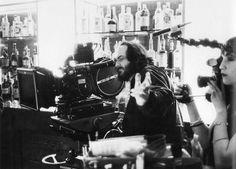 Stanley Kubrick films a shot on the Gold Room Bar set of The Shining as his daughter, Vivian, shoots her documentary on the making of the film.