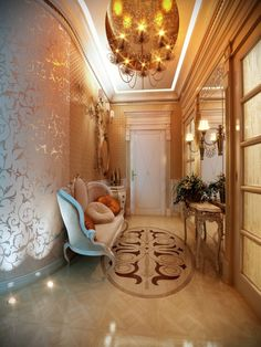 Even hallways can feel regal with the right trappings. Here, the use of a brocade wallpaper and mirrors make the space feel big and expensiv...