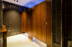 Ironwood Manufacturing wood veneer toilet partition and bathroom doors. Beautiful, upscale public restroom stalls.