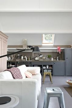 Have always wanted a sofa in my ktichen. Love the wall lights and simple grey cupboards www.homesalemalta.com