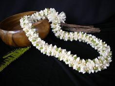The cream colored flowers in this ribbon lei are meant to replicate the popular Rope Pikake lei. Organza ribbon adds greenery while gold ribbon contributes the sparkle. This lei is 38 inches long. Handmade Flowers, Diy Flowers, Fabric Flowers, Ribbon Lei, Organza Ribbon, Ribbon Flower, Hawaiian Crafts, Graduation Leis, Fabric Garland