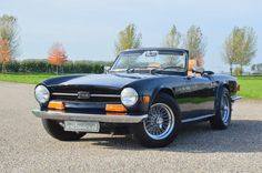 """For sale, beautiful Triumph TR6 performed in the chic color dark blue combined with a beige leather interior. This car was delivered new in America, and was shipped to The Netherlands in 2006. Then, in the Netherlands a very extensive """"Body off"""" restoration was started, which was completed in April 2008. The Triumph TR6 has... verander mij in extras.php"""