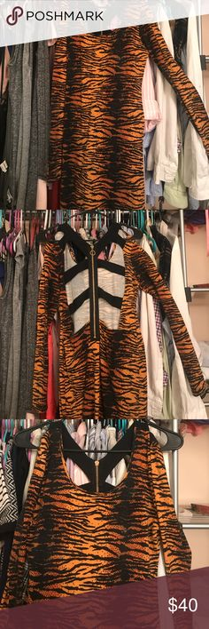 Sexy back MinkPink tiger print dress Sexy tiger print mink pink dress. With open /strappy. Back. Worn once in perfect condition. MINKPINK Dresses Mini