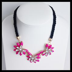 Stunning Diva Pink Jeweled Necklace on a Black Cord .