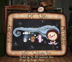 Hand painted vintage suitcase. Perfect for keeping mittens and scarves in.  http://www.theoldcupboarddoorblog.com/