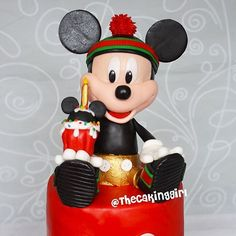It's Mickey Mouse in Gucci gear birthday cake! He's edible, hand made out of gumpaste. Close up of the Mickey Figurine! ••For my tutorials, visit my Youtube!⬆️ Link in bio! ⬆️ Thank you!