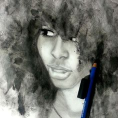 Doodling with Graphite, pastel to make a finger print afro