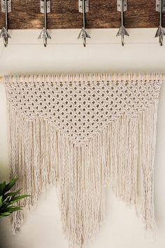 Beautiful, original macrame wall hanging. Can be hung either from the wooden rod, or (included) hanging rope. Fine attention to detail, and made with an extra dose of love for the art! -21 inches wide and 24 inches long (without hanging rope) -26.5 inch wooden rod We love making macrame pieces, and thoroughly enjoy the fact that many people have chosen one of our pieces for their home decor! Please let us know if you have any questions about this or another piece. We have been accused of…