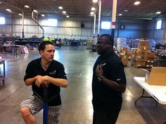 Jose and Quincy discuss production challenges on the shop floor.  Keep those squeegees humming!!  www.visualimp.com