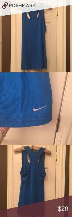 Nike Tank Blue ribbed racerback tank. Dri-fit, tight fit. Perfect condition like brand new. Worn maybe once Nike Tops Tank Tops