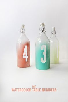 Buzzfeed posted 25 ideas for IKEA DIYs for fun wedding day decor. #1 Add some color to KORKEN bottles and use them to display table numbers.