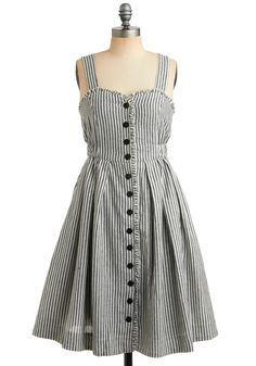I love this cute little dress.  I like the pinstriping on it and I really like the buttons.  It reminds me of a pair of 'train conductor' play clothes that my grandma made me as a kid.