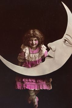 A little girl and a Paper Moon