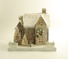 Vintage Mica Putz Houses can be purchased on eBay, or you can find them new at places like Marshall's. They're typically decorated with lots of glitter and bottle brush trees. You can fit a battery operated tealight inside them to light them up too. Great for a Christmas village!