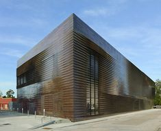 Louisiana State Museum by Trahan Architects with pleated copper panels