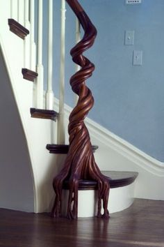 "This piece is called ""Roots of Rail"". It was created by an outfit called North Road Woodshop in Foster, Rhode Island. The owner and head stair builder is Jed Dixon, but it was one of his craftsmen, Mike Kennedy, who did most of the carving. The house is a total gut renovation of, and addition to, a Second Empire home in Cambridge, Massachusetts. The architect is Matt Sargent of Hickox Williams Architects. The photo was taken by Peter Vanderwarker."