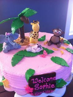 safari baby shower cake - This cake was made for a friends safari themed baby shower.  The  baby was made from a silicone mold, and the animals and the tree I made from gum paste.  She was very happy with it.