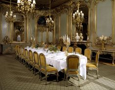 The French Dining Room with Rococo 'boiseries' panelling & marble chimney-piece from the Chateau d'Asnieres, near Paris.