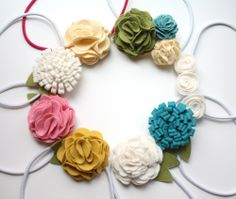 All kinds of felt flowers. Some might work with other fabrics.
