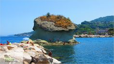 Sunbathing on Il Fungo (The Mushroom) Rock in Lacco Ameno, Ischia