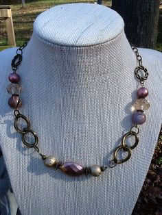 Antique brass chain links combined with rose tone beads finished with antique brass chain.